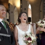 The Bride and the Groom laughing at the Chapel. Hotel Palacio de Santa Paula, weddings, Granada, Spain.