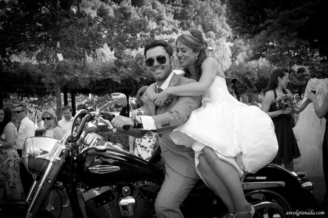 Bride & Groom arriving at the wedding venue, Palacio de los Cordoba, on a motor bike