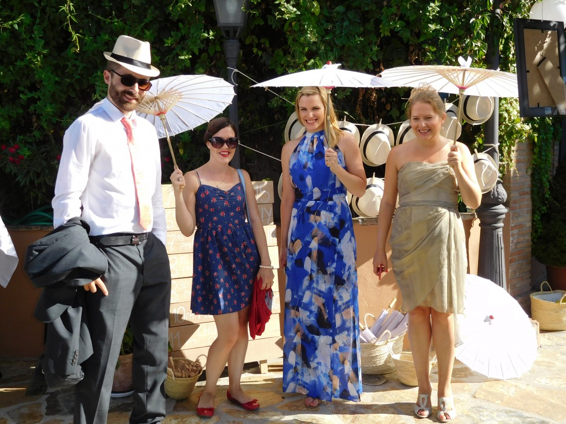Wedding Guests Enjoying Hats & Parasols