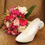 Flowers and brides shoe. Wedding at El Parador, Granada, Spain.