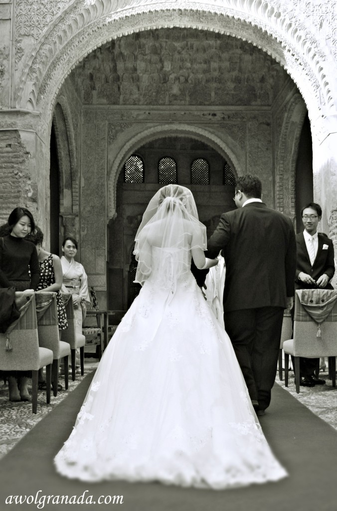 Bride walking down the aisle from the back, wedding, Granada, Spain.