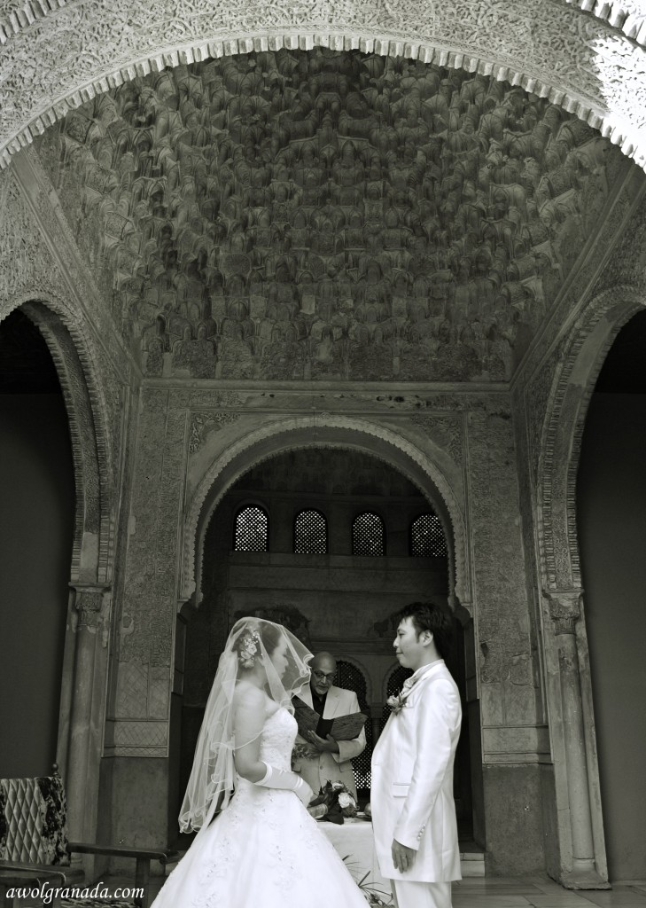 Facing each other, at the Parador Chapel, weddings, Granada, Spain.
