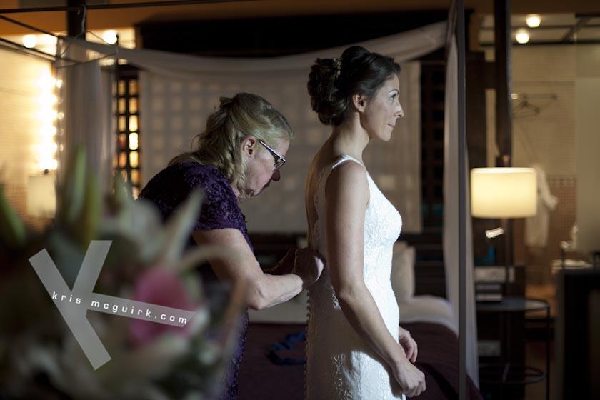 The Bride's Mum helping her closing the Wedding Dress buttons. Hotel Palacio de Santa Paula, Granada,Spain.
