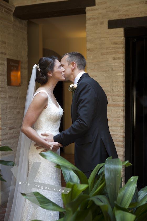 The Groom kissing the Bride. Hotel Palacio de Santa Paula, Weddings, Granada, Spain.