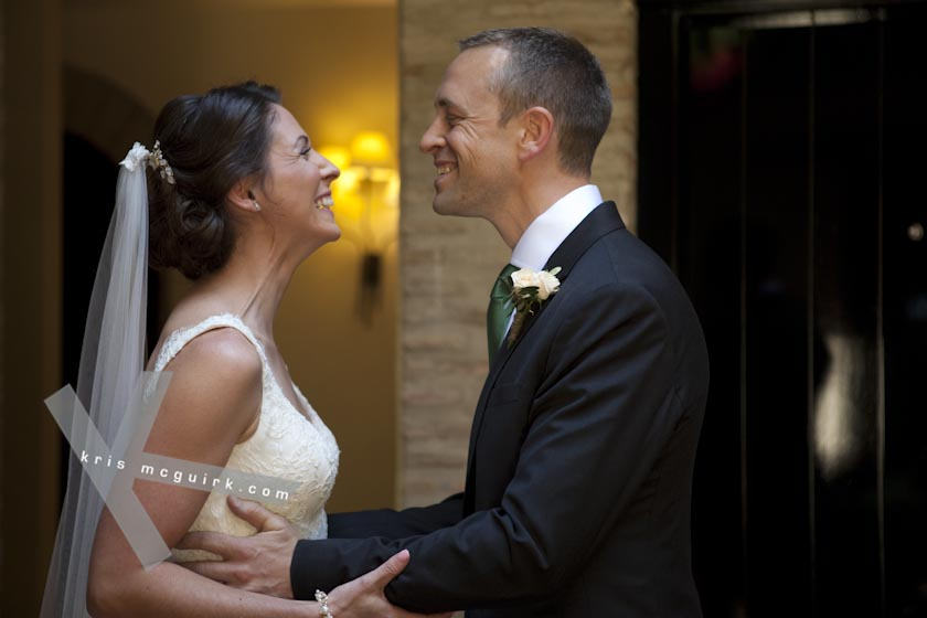 The Bride and the Groom smiling at each other. Hotel Palacio de Santa Paula, weddings, Granada, Sapin.