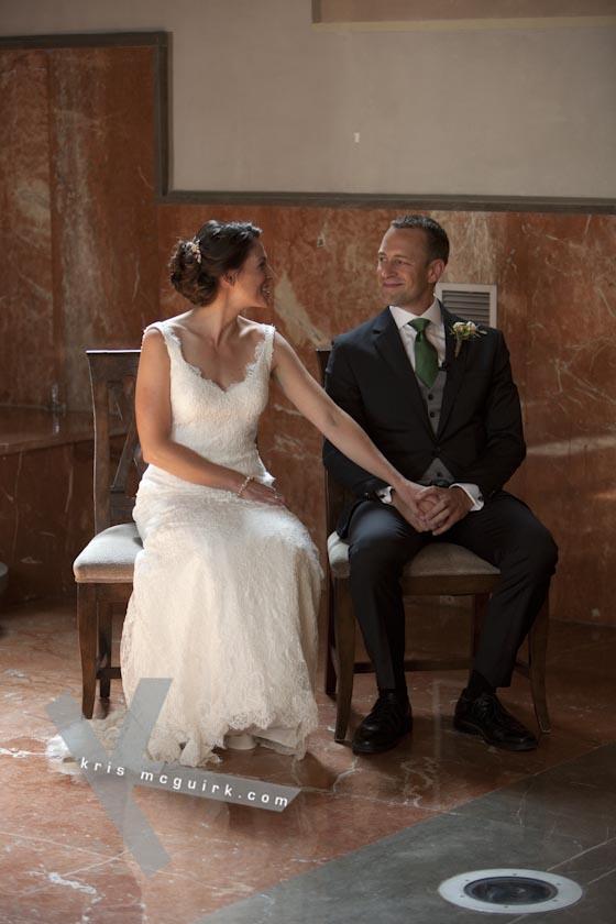 The Bride and the Groom holding hands at the Chapel. Hotel Palacio de Santa Paula, Granada, Spain.