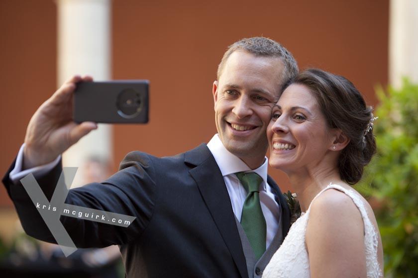 The Bride and the Groom taking a Selfie. Hotel Palacio de Santa Paula, Weddings, Granada, Spain.