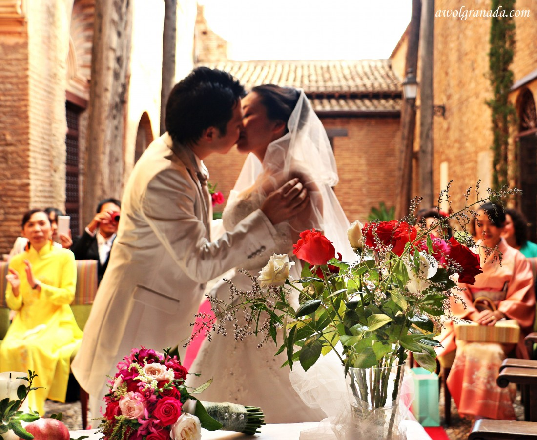 The kiss, weddings, at the Parador, Granada, Spain.