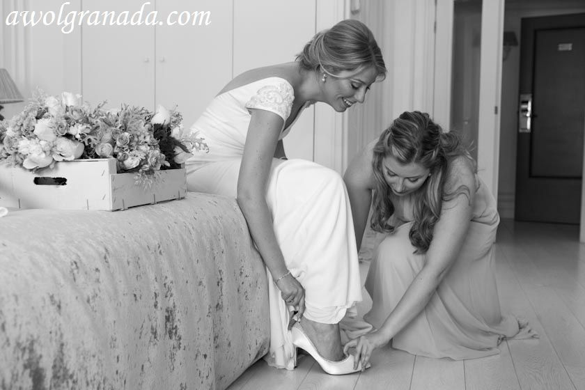 Being helped with the shoes
