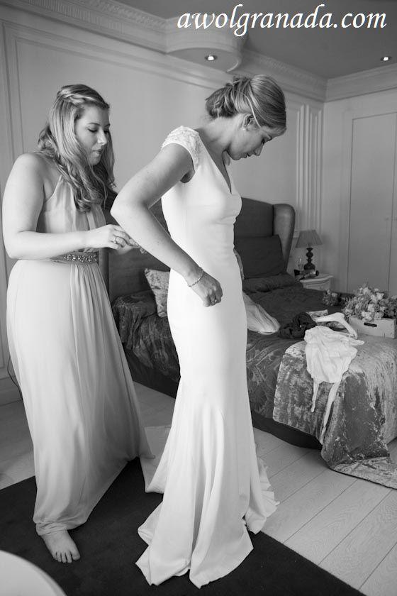 Bride being helped