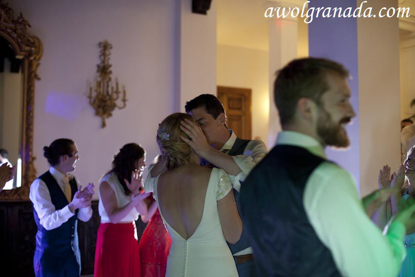 The Couple kissing at the party