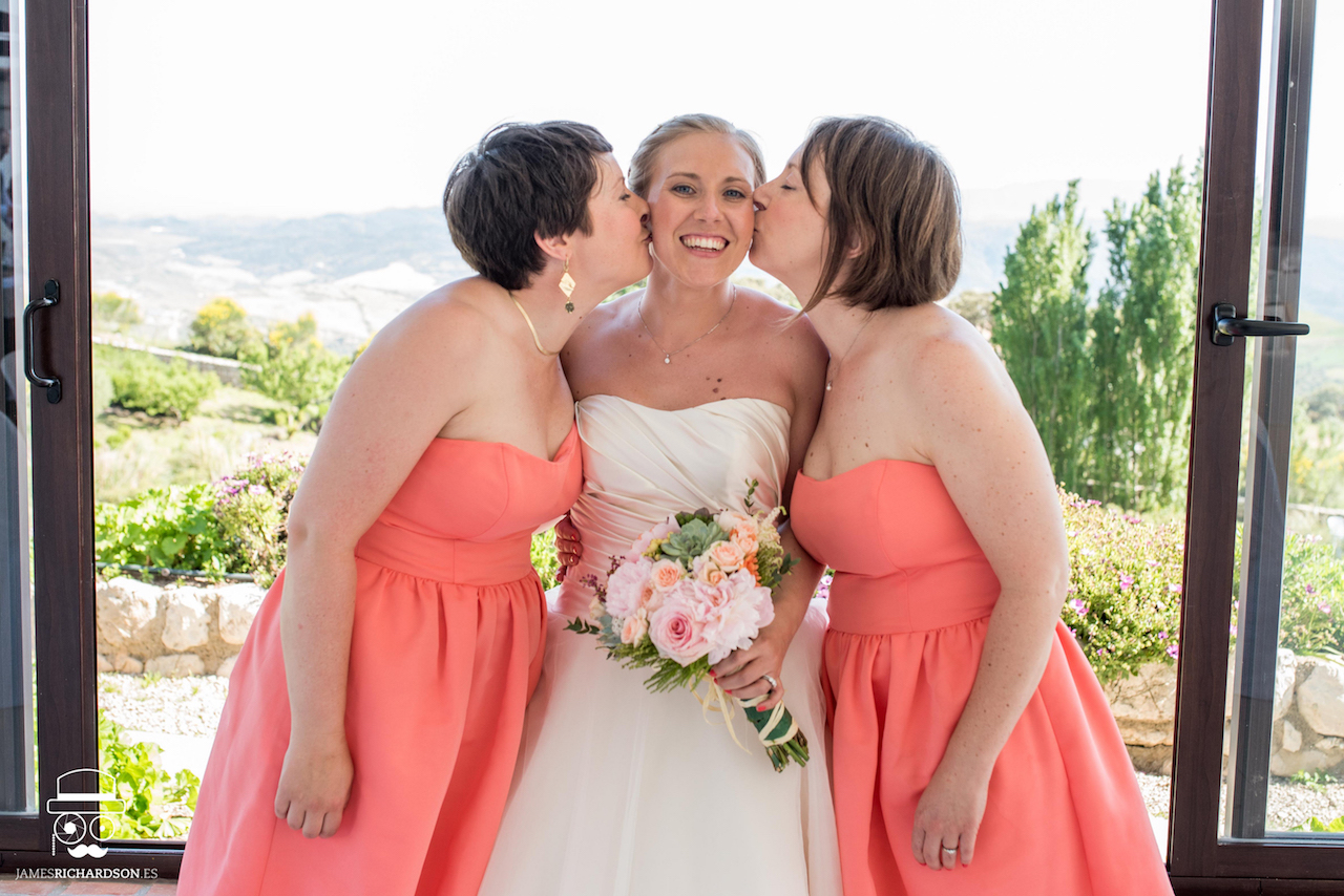 The bride and her 2 sisters as bridesmaids