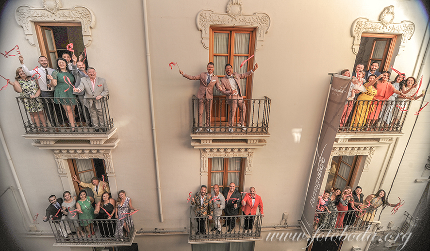 The wedding party on the balconies of the Hotel Parraga Siete