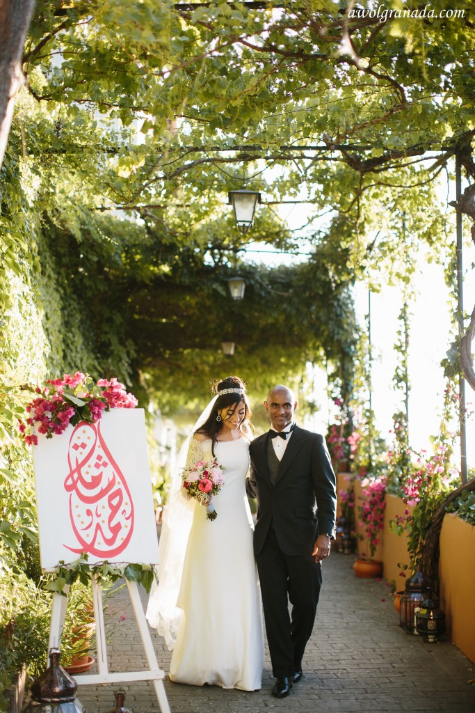 The beautiful couple walking through the entrance