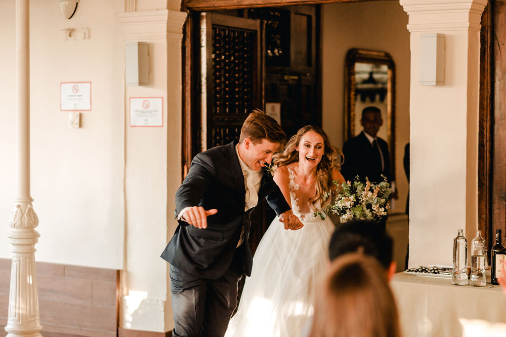 Bride and groom running into the wedding reception - AWOL Granada Wedding Planner Spain