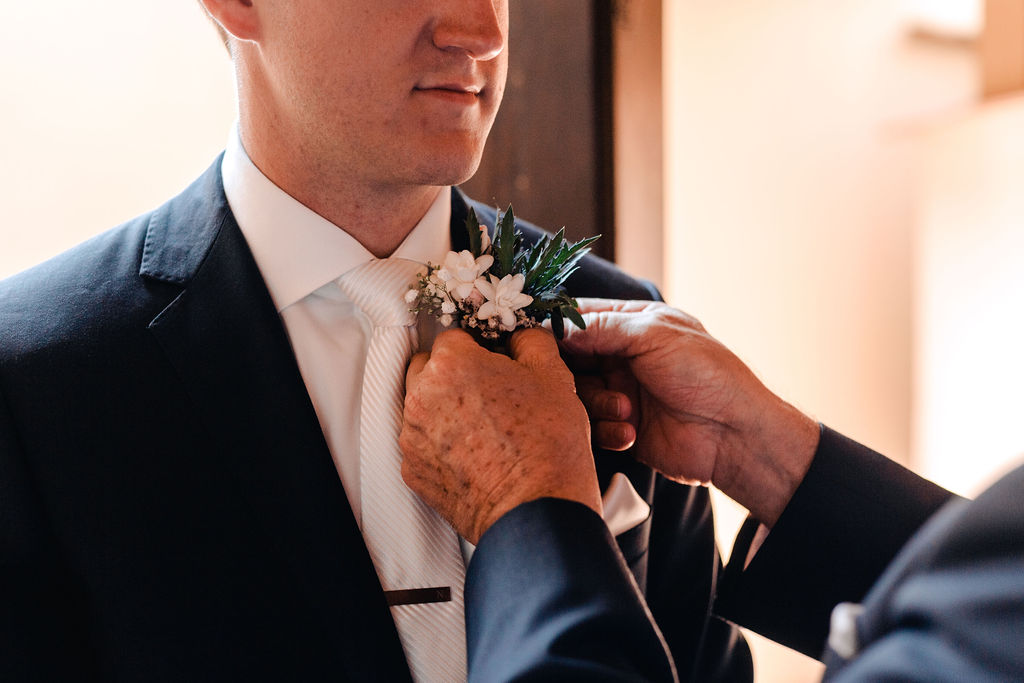 Finishing touches with the Boutonniere - AWOL Granada Wedding Planner Spain