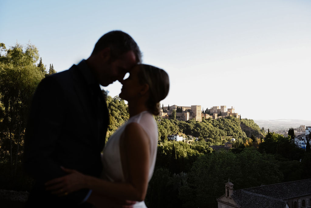 The bride and groom in front of the Alhambra - AWOL Granada, Wedding Planner, Spain
